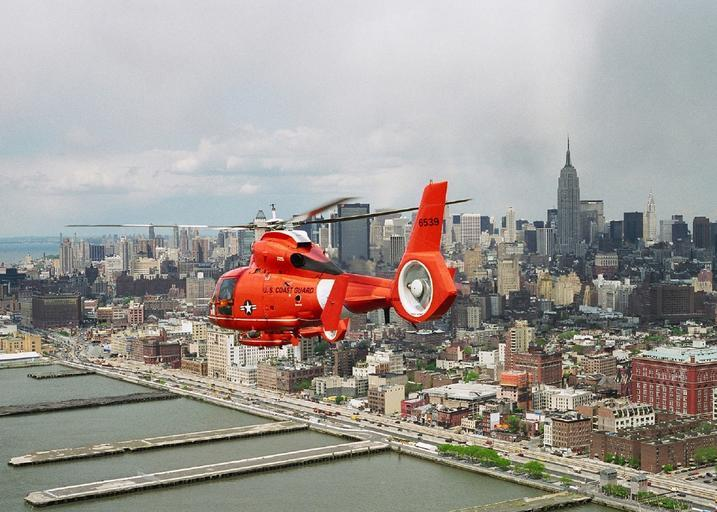 helicopter manhattan new york coast guard flying island city docks river wharf freedom symbol monument patrol military business seaport metropolitan flight chopper aircraft guard james mackey aviation