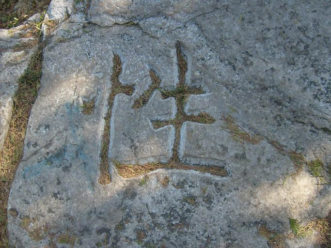 carving stone rock symbol hieroglyph chinese character