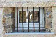 window-old-house-facade-bars-wall-508567.jpg